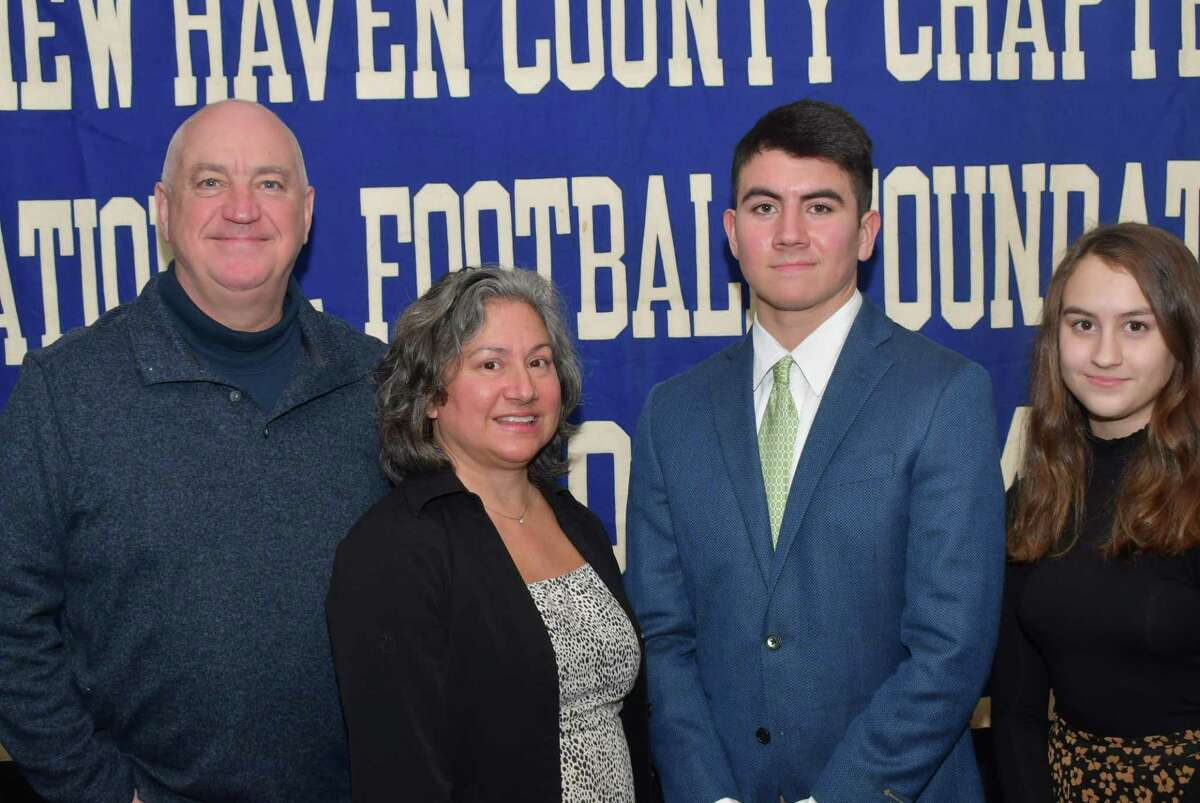 Guilford's Evan Russell has been named a scholar athlete by the Casey-O'Brien New Haven County Chapter of the National Football Foundation and College Hall of Fame. He is picturedwith his parents John and Anna and sister Maeve.