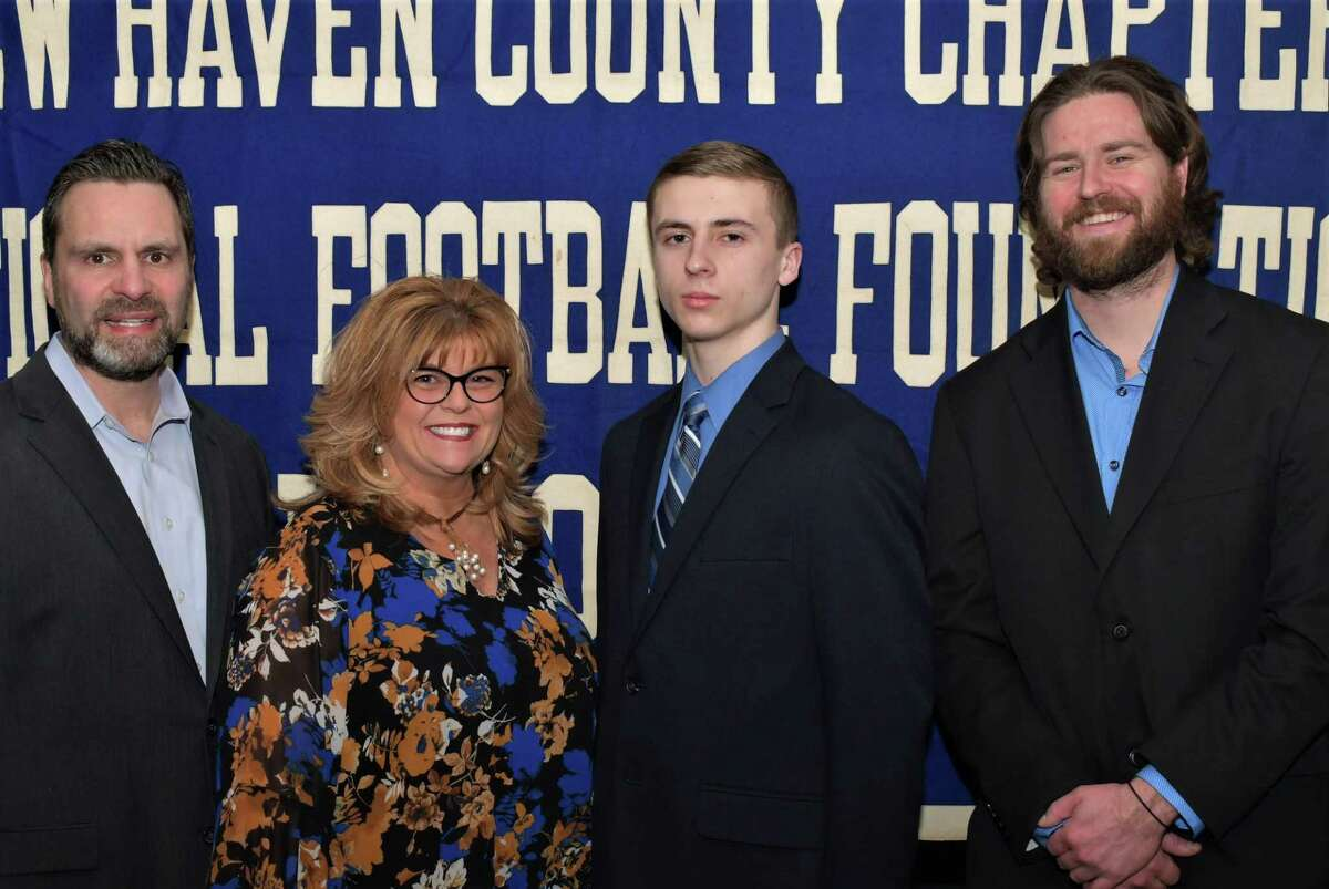 Seymour's Nicholas Todicehas been named a scholar athlete by the Casey-O'Brien New Haven County Chapter of the National Football Foundation and College Hall of Fame. He is pictured with hisparents Joseph and Lori (L) and coach Mike Kearns.