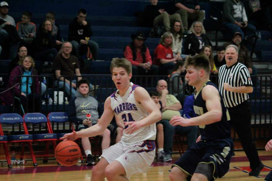 Levi Rogers takes the ball to the hoop in late season action for Chippewa Hills. (Pioneer file photo)