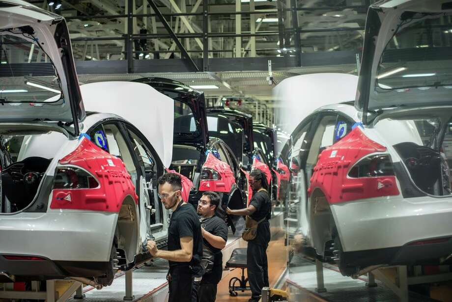 The assembly line at Tesla's factory in Fremont, California. Photo: David Butow/Corbis Via Getty Images