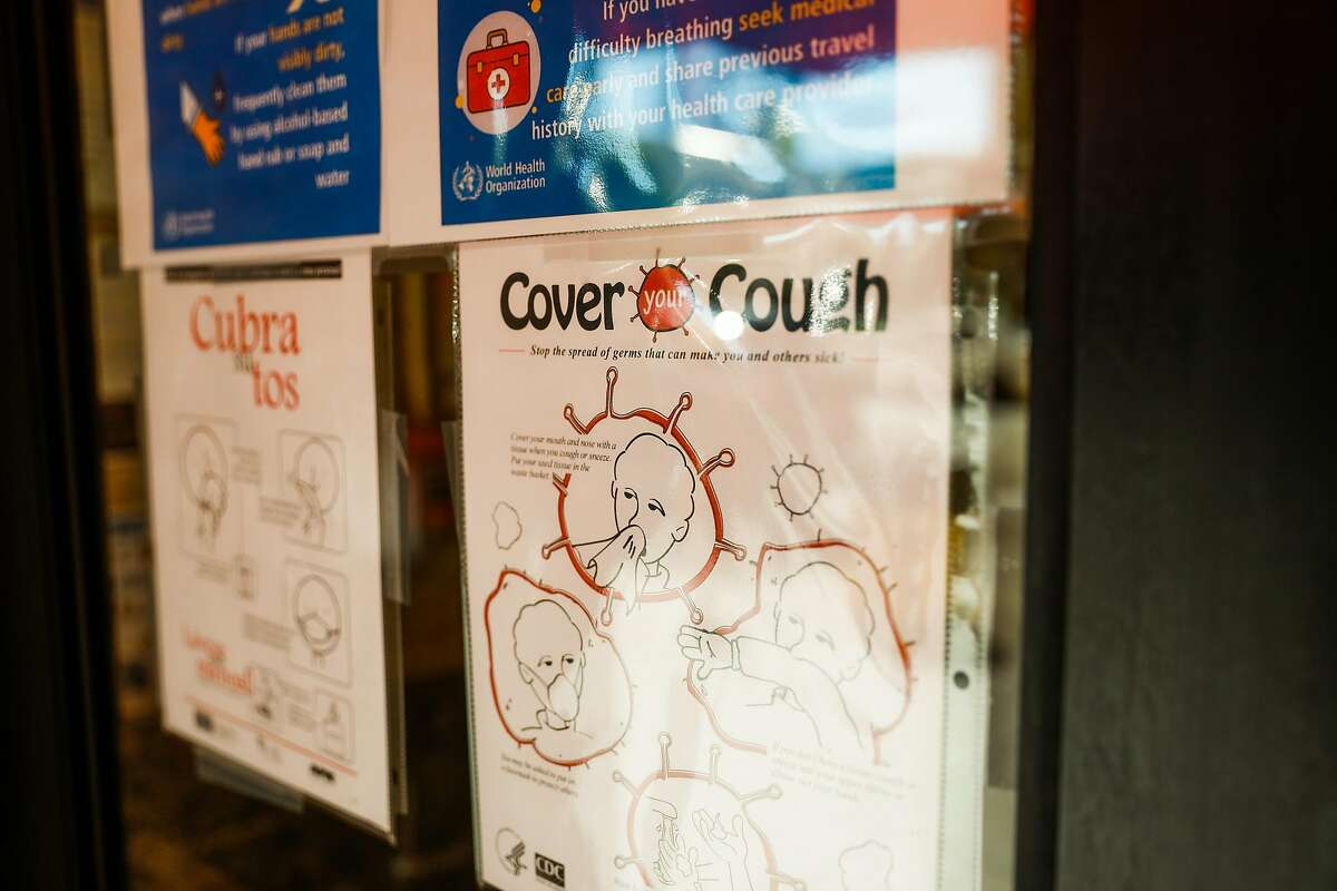A sign saying 'Cover your Cough' hangs outside Glide Memorial Church in San Francisco.