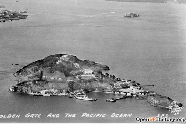 Aerial view of Yerba Buena Island from 1930 with the city and the Golden Gate in the background.