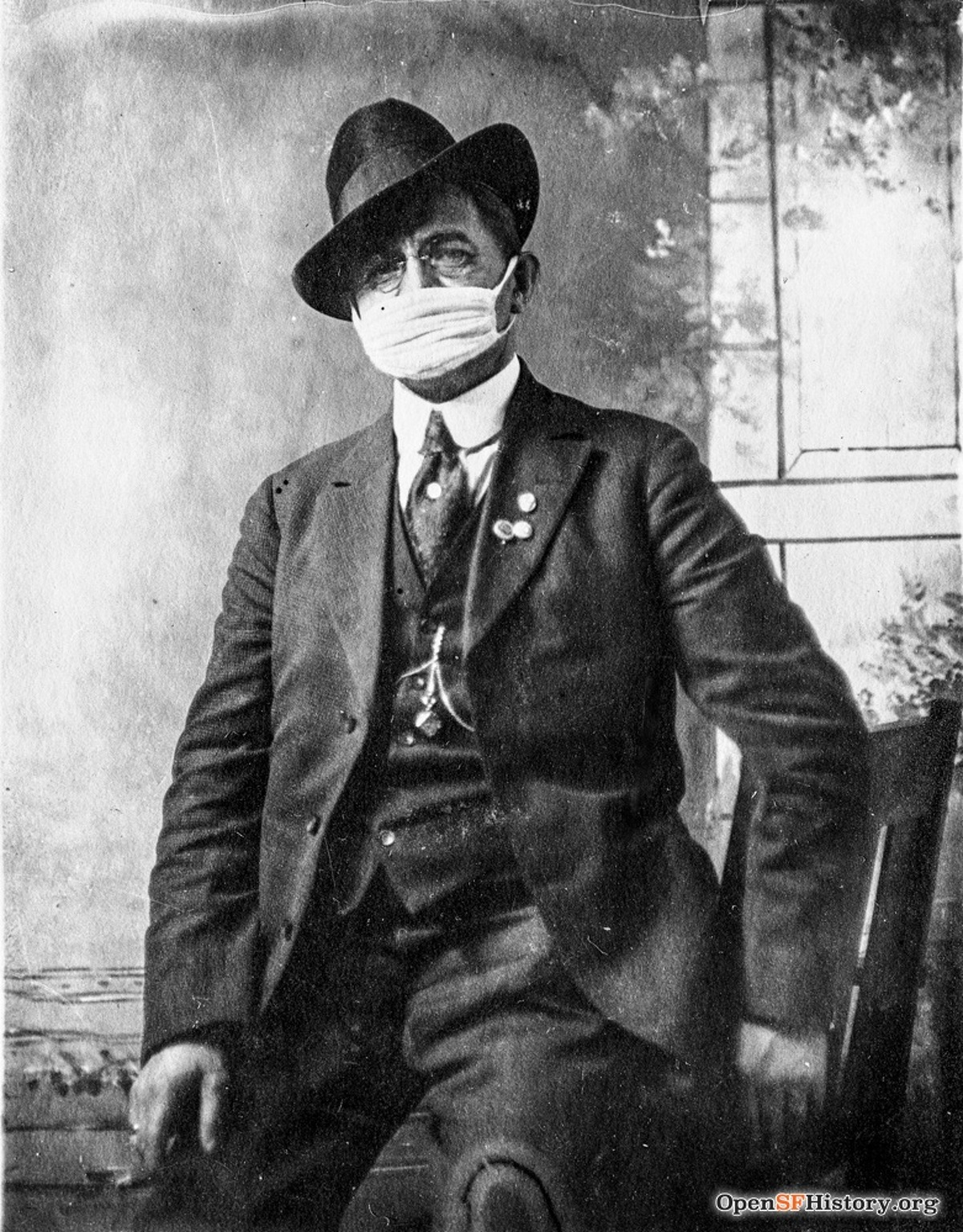 A man in San Francisco poses for a photograph while wearing an wearing influenza mask during the 1918 Spanish Flu Pandemic.