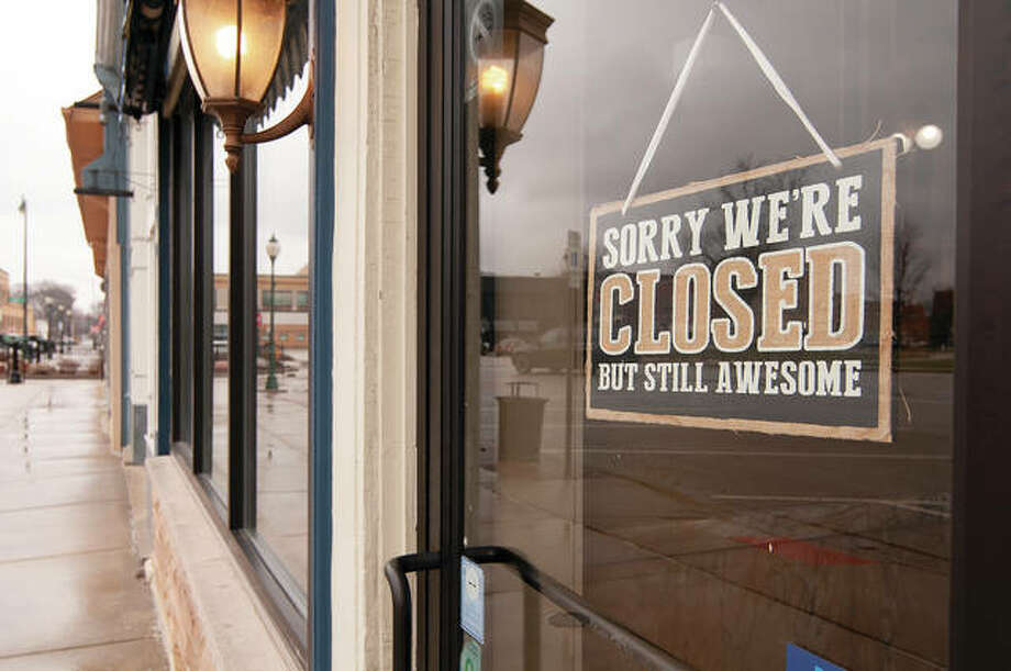 Signs like this one began appearing on restaurant doors across Illinois on Monday, when a ban on dine-in eating took effect. The ban, which runs through at least March 30, is an attempt to prevent or slow the spread of the COVID-19 virus.