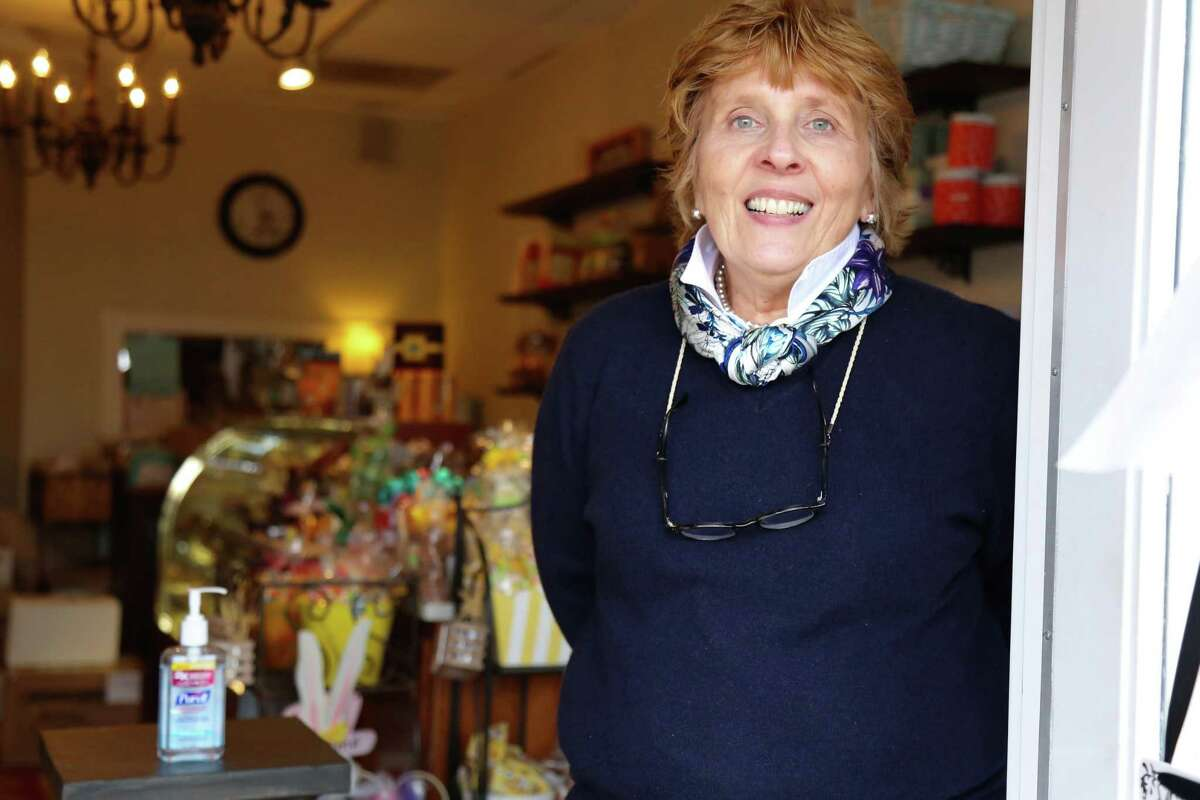 Nancy Saxe, owner of Sweet Pierre's, is welcoming customers into the store one at a time, where they're requested to make use of hand sanitizer.