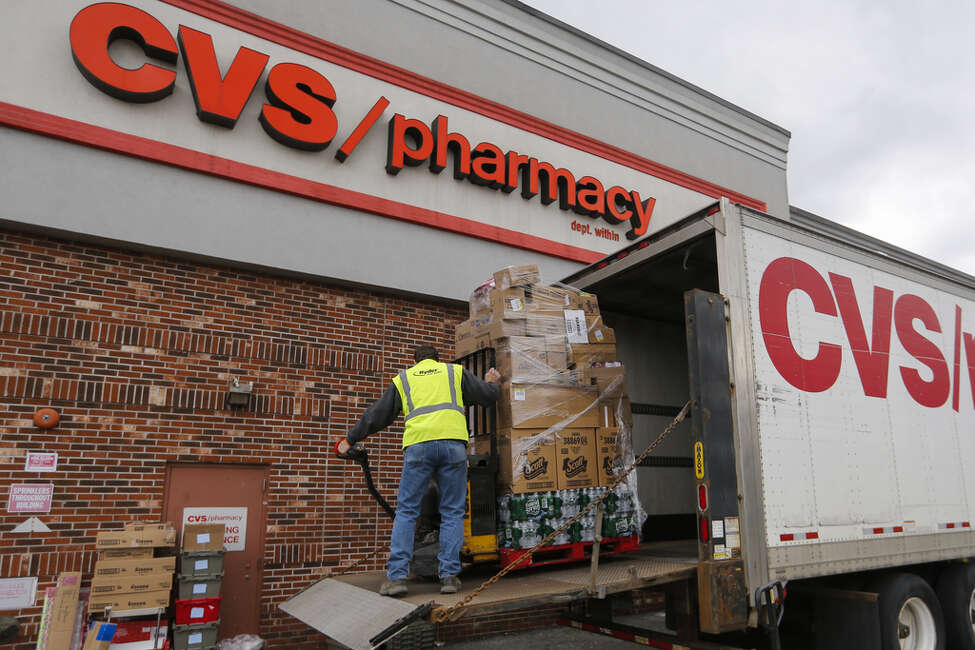 A driver unloads merchandise from a delivery truck outside a CVS Health Corp. location in New Rochelle, New York, U.S., on Monday, March 16, 2020. The governors of New York, New Jersey and Connecticut banned all gatherings of 50 or more people, and said bars, restaurants, casinos and gyms must close Monday at 8 p.m. Photographer: Angus Mordant/Bloomberg