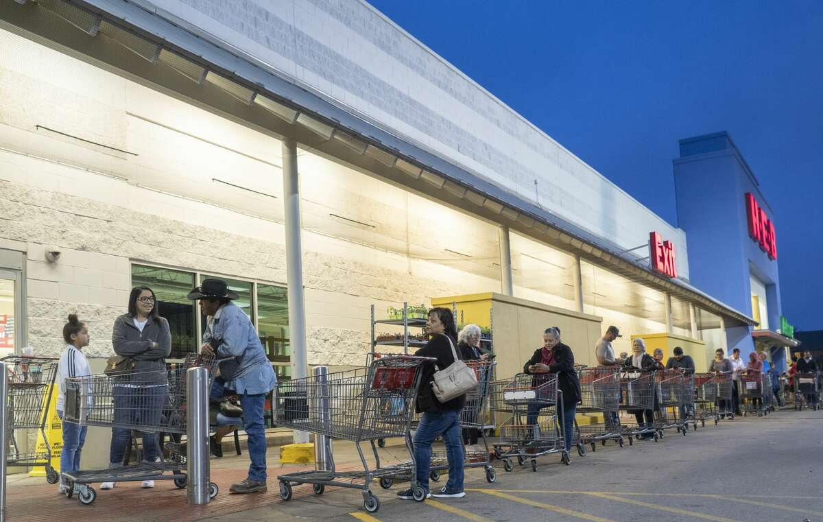 Shoppers line up 03/17/2020 morning outside HEB on Wadley as they wait for the store to open at 8 A.M.. Tim Fischer/Reporter-Telegram