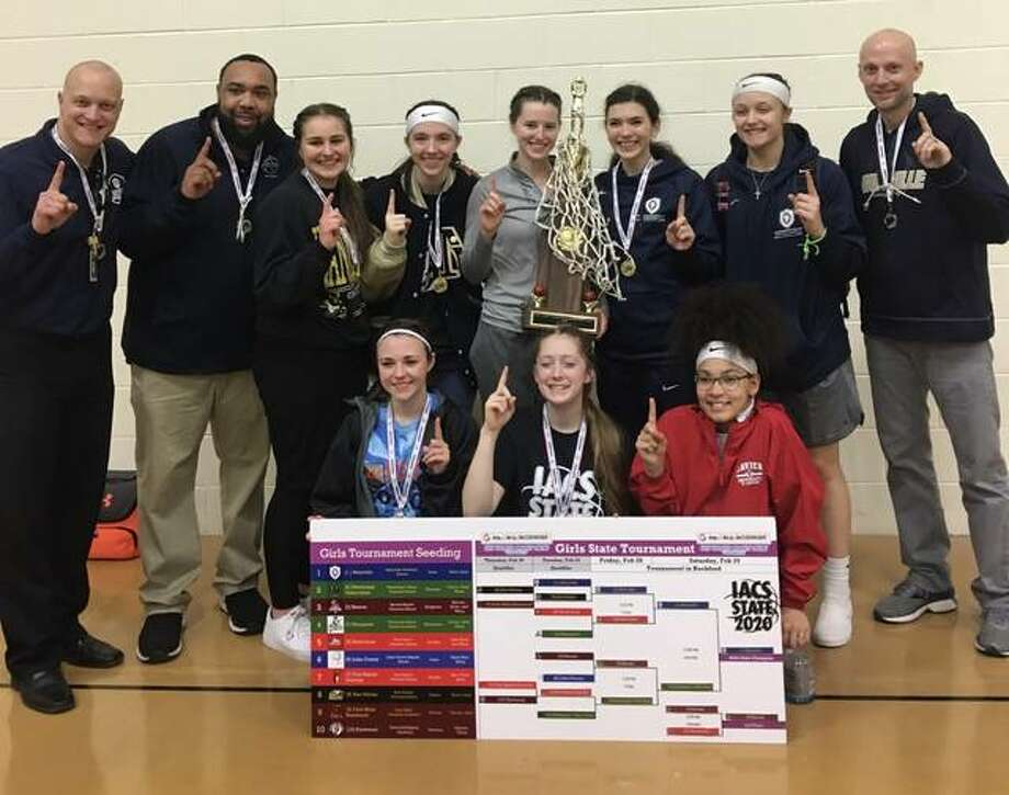 The Maryville Christian School girls basketball team poses for a photo after winning the Illinois Association of Christian Schools state tournament on Feb. 28-29 at Berean Baptist Christian School in Rockford. Photo: For The Intelligencer