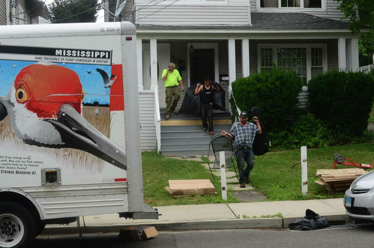 People are evicted from their home in 2016 in Norwalk.