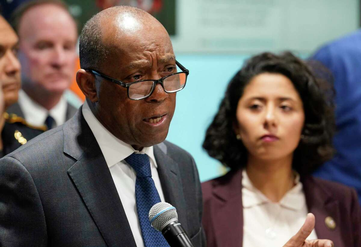 Houston Mayor Sylvester Turner, left, and Harris County Judge Lina Hidalgo, hold a COVID-19 news conference at Houston TranStar March 16, 2020, in Houston, to announce the closures of bars and limits on restaurants.