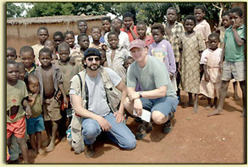 Photographer Steve Jacobs and reporter Paul Grondahl with kids in Lilongwe, Malawi, during our 2003 16-day trip to Malawi to report on the effects of the HIV/AIDS global pandemic that has killed millions of people in sub-Saharan Africa (Provided photo)