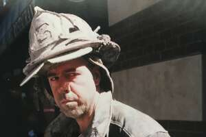 This was the scene near      Ground Zero in Lower Manhattan on Sept. 11, 2001 just after the second      tower of the World Trade Center fell and Building No. 7 in the complex      began to burn and teeter. It fell later in the afternoon. (Paul Grondahl /      Times Union)  I spoke with this      shellshocked firefighter who had helped with the evacuation of the World      Trade Center towers before they fell (Paul Grondahl / Times Union)  First responders,      medical personnel, emergency management officials of volunteers all worked      together to mitigate the terrorist attacks on the World Trade Center that      killed 2,753 people and injured 6,000. The victims included 343 New York      City firefighters, 23 police officers and 37 Port Authority      employees (Paul Grondahl / Times Union)  Former Times Union      photographer Steve Jacobs and reporter Paul Grondahl worked together at      Ground Zero for six days following the 9/11 terrorist attacks and we      developed an unspoken language of teamwork that kept us safe in a      dangerous situation (Paul Grondahl / Times Union)  Photographer Steve      Jacobs and reporter Paul Grondahl with kids in Lilongwe, Malawi, during      our 2003 16-day trip to Malawi to report on the effects of the HIV/AIDS      global pandemic that has killed millions of people in sub-Saharan Africa      (Provided photo)