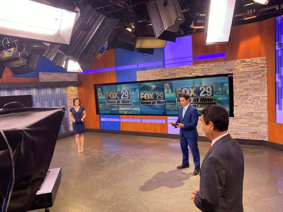 FOX-29 anchors Camilla Rambaldi, Ryan Wolf practice social distancing while they broadcast the news. Photo: Alex Garcia