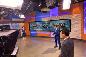 FOX-29 anchors Camilla Rambaldi, Ryan Wolf practice social distancing while they broadcast the news.