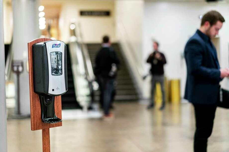 A new dispenser of hand sanitizer sits near the Senate trains on Capitol Hill in Washington. Photo: Washington Post Photo By Melina Mara / The Washington Post