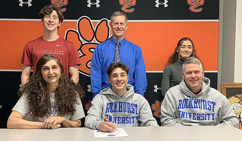 Edwardsville senior Jakob Doyle will play college soccer at Rockhurst University. He is joined by his family and EHS coach Mark Heiderscheid. Photo: Matt Kamp|The Intelligencer