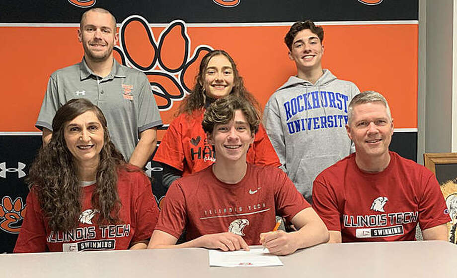 Edwardsville senior Mathiew Doyle, seated center, will swim for Illinois Tech in Chicago. He is joined by his family and EHS coach Christian Rhoten.