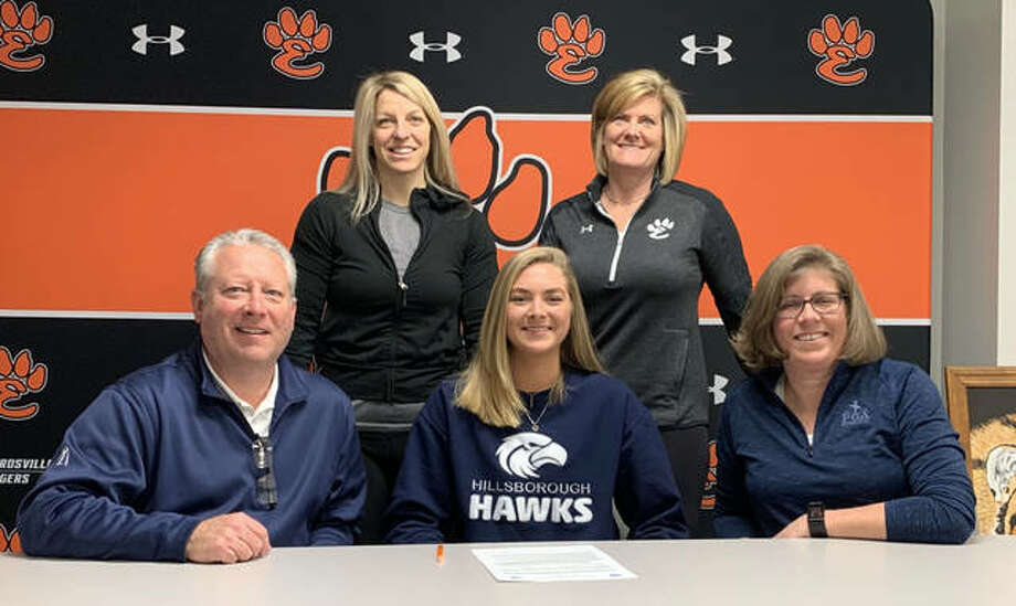 Edwardsville senior Lexie Curtis, seated center, will play volleyball at Hillsborough Community College in Tampa. She is joined by her family and EHS coach Lisa Orlet. Photo: Matt Kamp|The Intelligencer