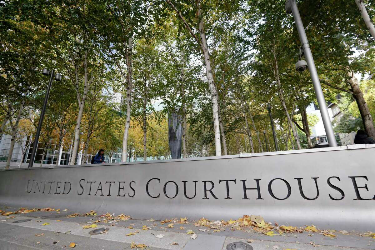 This Nov. 6, 2019 file photo shows the U.S. Courthouse in Seattle, fronted by a tree-lined courtyard.