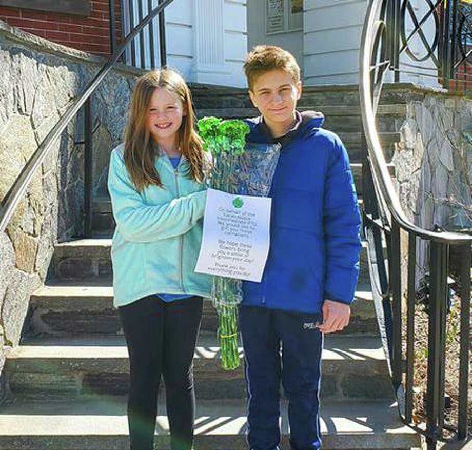 Students from Sarah Noble Intermediate School delivered flowers around New Milford to thank various groups for their response and help during the coronavirus outbreak. Photo: Contributed Photo / Facebook