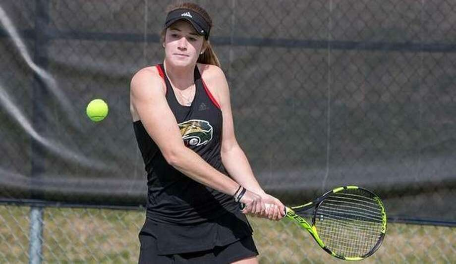 SIUE's Callaghan Adams prepares to hit a shot during a match last season. Adams is a redshirt junior for the Cougars, who recently learned their season has been canceled because of the coronavirus outbreak. Photo: SIUE Athletics