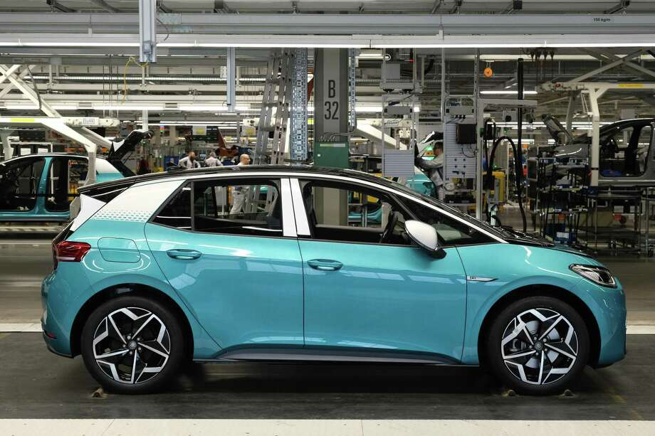 ZWICKAU, GERMANY - FEBRUARY 25: VW ID.3 electric cars emerge on the assembly line at the Volkswagen factory on February 25, 2020 in Zwickau, Germany. Volkswagen is gradually revving up ID.3 production at the Zwickau plant from a current 110 per day to an eventual 1,500. The Zwickau plant is the first of its many factories that Volkswagen is retooling from producing combustion engine cars to only producing electric cars. Sales of the ID.3 will begin this summer. (Photo by Sean Gallup/Getty Images) Photo: Sean Gallup, Staff / Getty Images / 2020 Getty Images