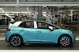 ZWICKAU, GERMANY - FEBRUARY 25: VW ID.3 electric cars emerge on the assembly line at the Volkswagen factory on February 25, 2020 in Zwickau, Germany. Volkswagen is gradually revving up ID.3 production at the Zwickau plant from a current 110 per day to an eventual 1,500. The Zwickau plant is the first of its many factories that Volkswagen is retooling from producing combustion engine cars to only producing electric cars. Sales of the ID.3 will begin this summer. (Photo by Sean Gallup/Getty Images)