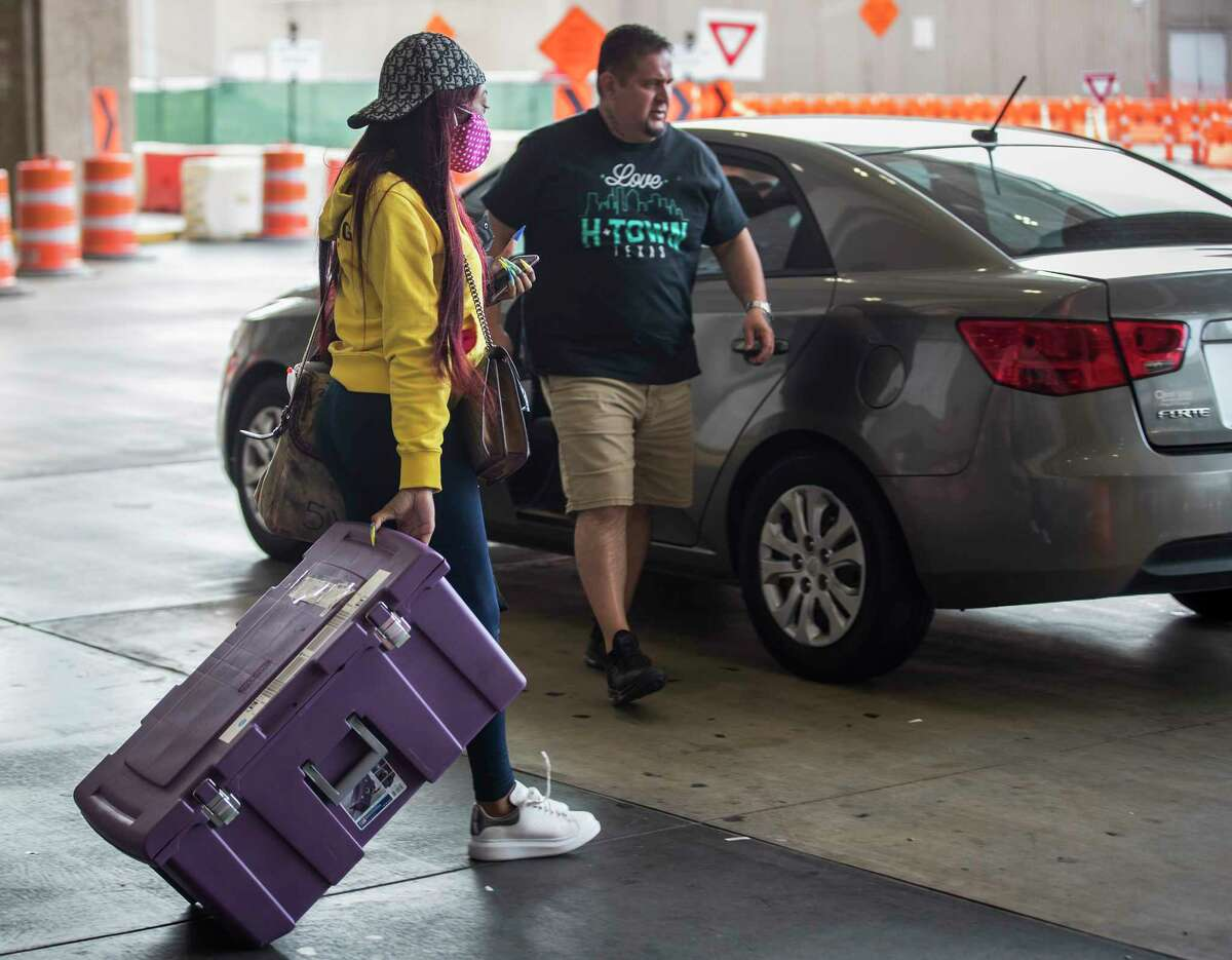 Terri Thomas walks to her rideshare on Tuesday, March 17, 2020 outside the Terminal C at George Bush Intercontinental Airport in Houston.