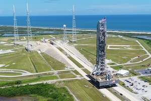 NASA's mobile launcher atop crawler-transporter 2 arrives at Launch Pad 39B on Aug. 31, 2018, at the agency's Kennedy Space Center in Florida. The mobile launcher will undergo a fit check, followed by several days of systems testing. The 380-foot-tall mobile launcher is equipped with the crew access arm and several umbilicals that will provide power, environmental control, pneumatics, communication and electrical connections to NASA's Space Launch System rocket and Orion spacecraft.
