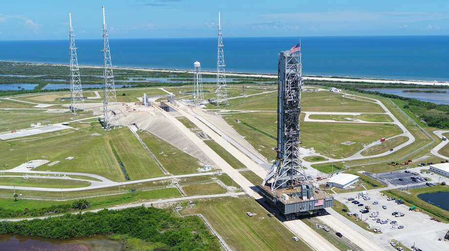 NASA's mobile launcher atop crawler-transporter 2 arrives at Launch Pad 39B on Aug. 31, 2018, at the agency's Kennedy Space Center in Florida. The mobile launcher will undergo a fit check, followed by several days of systems testing. The 380-foot-tall mobile launcher is equipped with the crew access arm and several umbilicals that will provide power, environmental control, pneumatics, communication and electrical connections to NASA's Space Launch System rocket and Orion spacecraft. Photo: NASA/Jamie Peer / For copyright and restrictions refer to http://www.nasa.gov/multimedia/guidelines/index.html