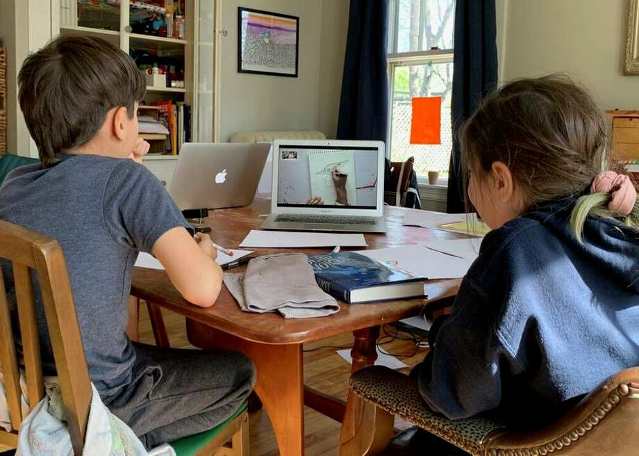 Kids in Portland, Maine, settle in for a day of home schooling. A growing list of states across the US, including Ohio, Maryland, Michigan and Virginia, have closed schools in an attempt to contain the coronavirus. Major cities including New York City and Los Angeles have done the same. Photo: CBSI/CNET