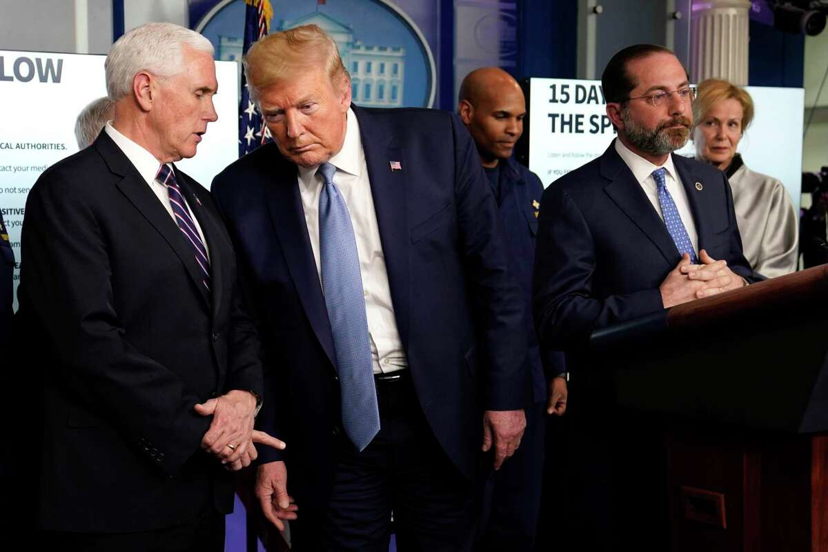 President Donald Trump listens to Vice President Mike Pence, left, as Health and Human Services Secretary Alex Azar speaks during a press briefing with the coronavirus task force, in the Brady press briefing room at the White House, Monday, March 16, 2020, in Washington. (AP Photo/Evan Vucci)