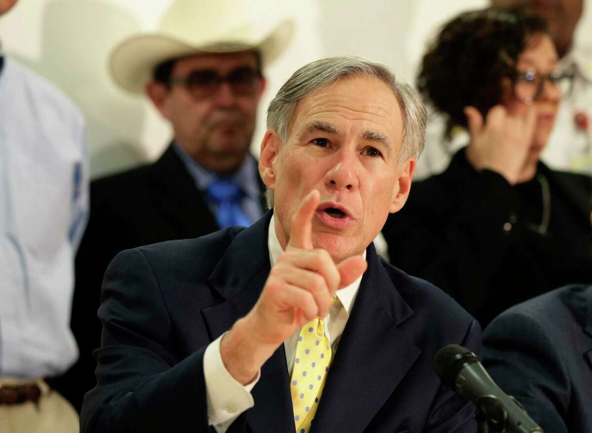 Texas Gov. Greg Abbott is joined by state and city officials as he gives an update on the coronavirus outbreak, Monday, March 16, 2020, in San Antonio. (AP Photo/Eric Gay)