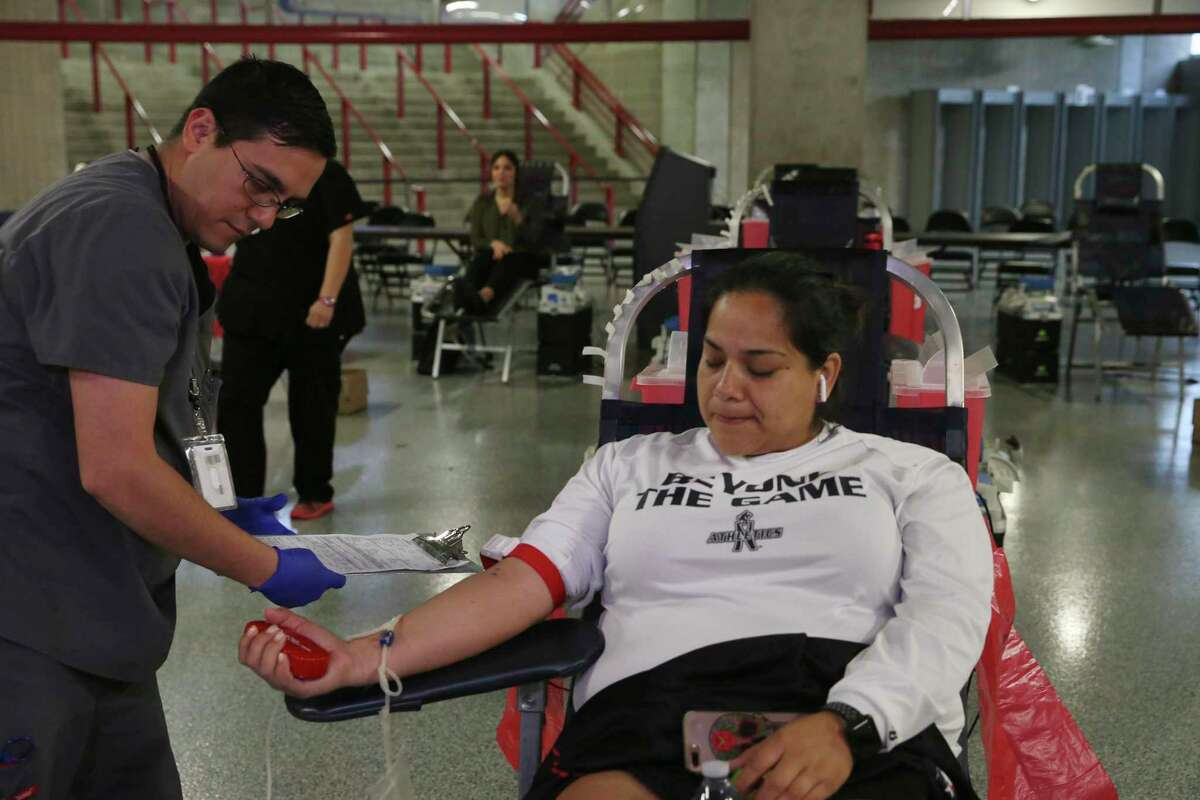 Victor Castillo, 32, sets up Michelle Martinez, 36, who is donating blood Tuesday, March 17, 2020. The city and South Texas Blood and Tissue Center are holding a three-day blood drive at the Alamodome from 9 a.m. to 5 p.m. May 21-23.