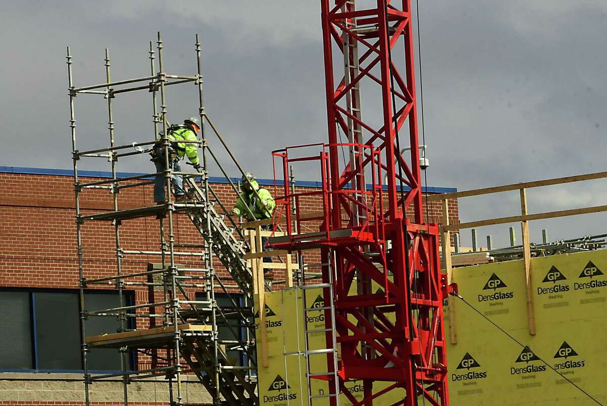 Construction work continues at the site of the new Hyatt Place Hotel on Tuesday, March 17, 2020 in Albany, N.Y. (Lori Van Buren/Times Union)