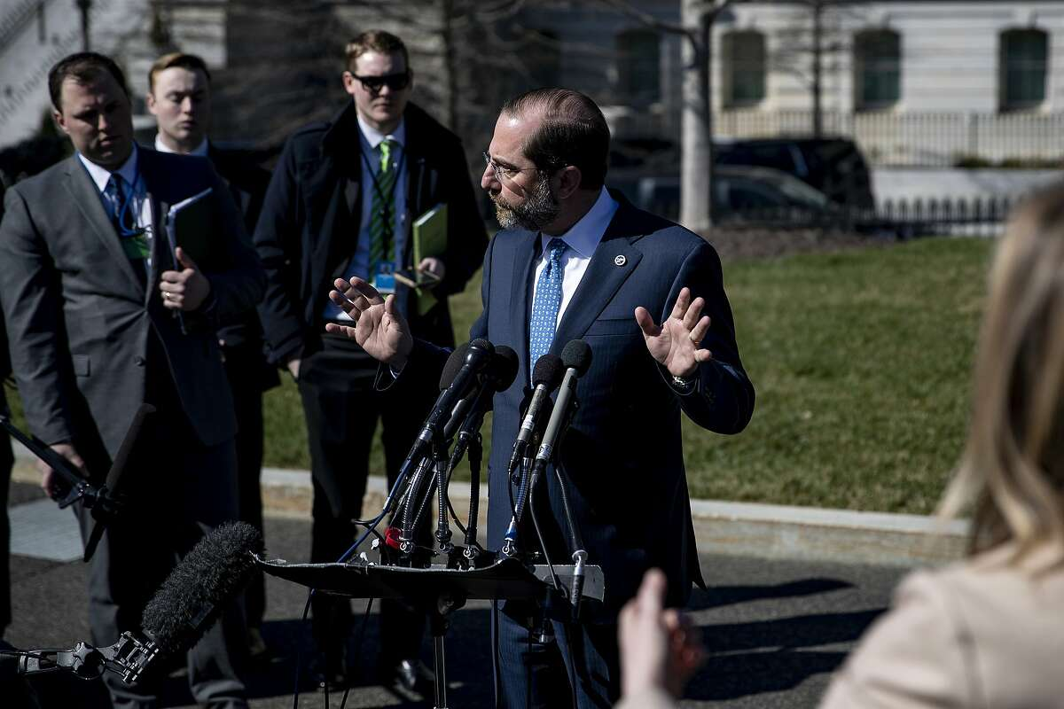 FILE -- Secretary of Health and Human Services Alex Azar speaks to reporters at the White House in Washington, March 9, 2020. Infighting, turf wars and a president more concerned with the stock market and media coverage than policy have defined the Trump White House - they have also defined how it has handled a pandemic. (Anna Moneymaker/The New York Times)