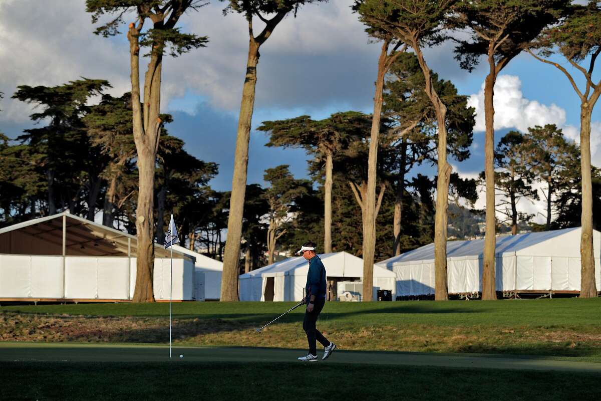 Johnson Lin finishes off the ninth hole at TPC Harding Park where preparations are underway for the 2020 PGA Championship in San Francisco, Calif., on Monday, March 16, 2020.