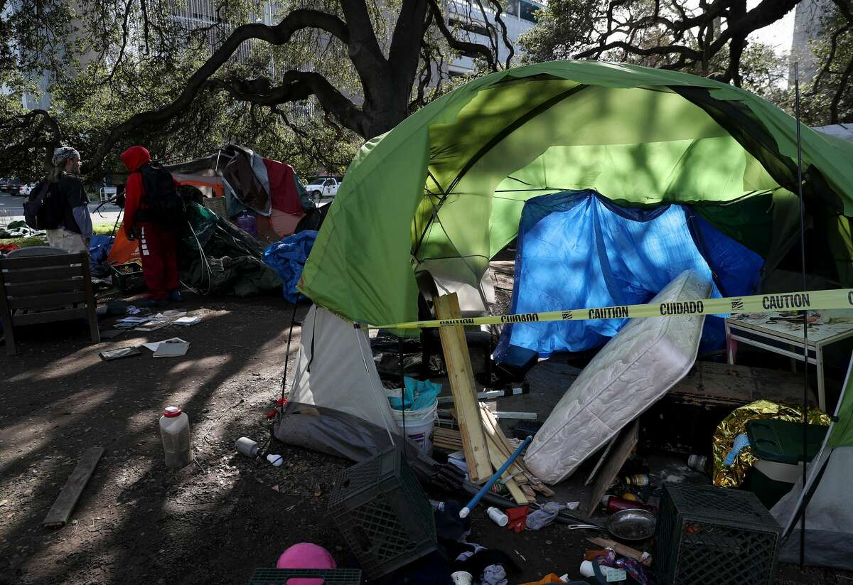 A tent is seen as Oakland Public Works Department employees remove debris from a homeless encampment at Mosswood Park in Oakland on Feb. 4, 2020. The state and local government are looking into ways to help and shelter the homeless during the shelter-in-place orders that were enacted throughout the Bay Area.
