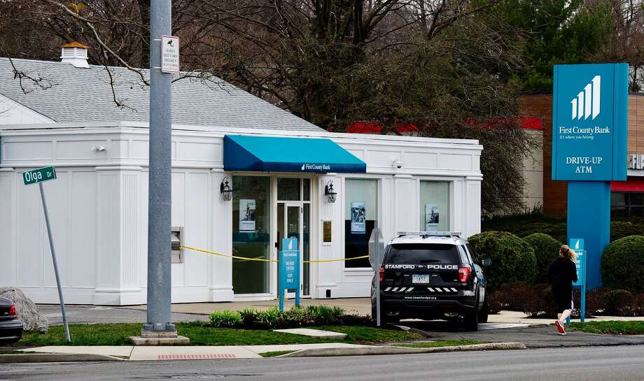 Police are investigating a robbery that took place at First County Bank on High Ridge Road early Tuesday afternoon. Photo: Matthew Brown / Staff