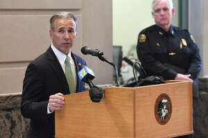 First Selectman Fred Camillo, seen here speaking two weeks ago at the Greenwich Police Department, said the town has been informed of seven deaths of coronavirus parients, including three residents.