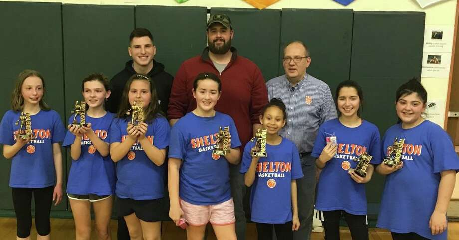 The Stars 5th grade junior varsity girls' basketball team won the Shelton Recreation League Division title at Mohegan School. Team members (front Row) are Emmy Reilly, Elaina Brilvitch, Madison Murawski, Lucy Zaccagnino, Brooke Ross, Lucia Wall and Brianna Pereira; (second row) Brandon Guittard, Tim Zaccagnino and Peter Brilvitch. Photo: Contributed Photo / Shelton Recreation Department / Shelton Herald