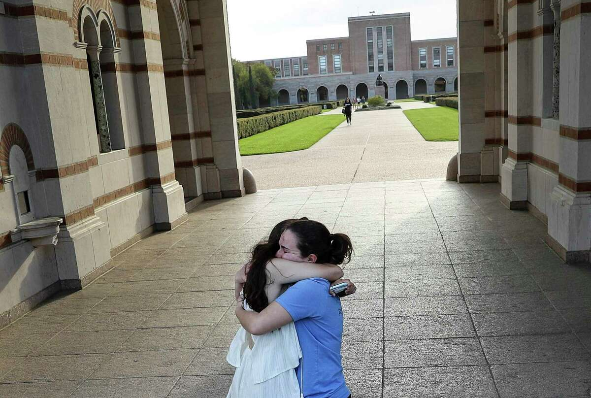 """Alessi Armengol, right, hugs her roommate of three years Julia Greenberg outside of Lovett Hall on Thursday, March 12, 2020, at Rice University in Houston. Campus officials announced that classes would move online for the remainder of the semester due to concerns about COVID-19. Both women are seniors. """"It's really sad, Rice has become my home,"""" Greenberg said. """"The people here have been the strongest network for me."""""""