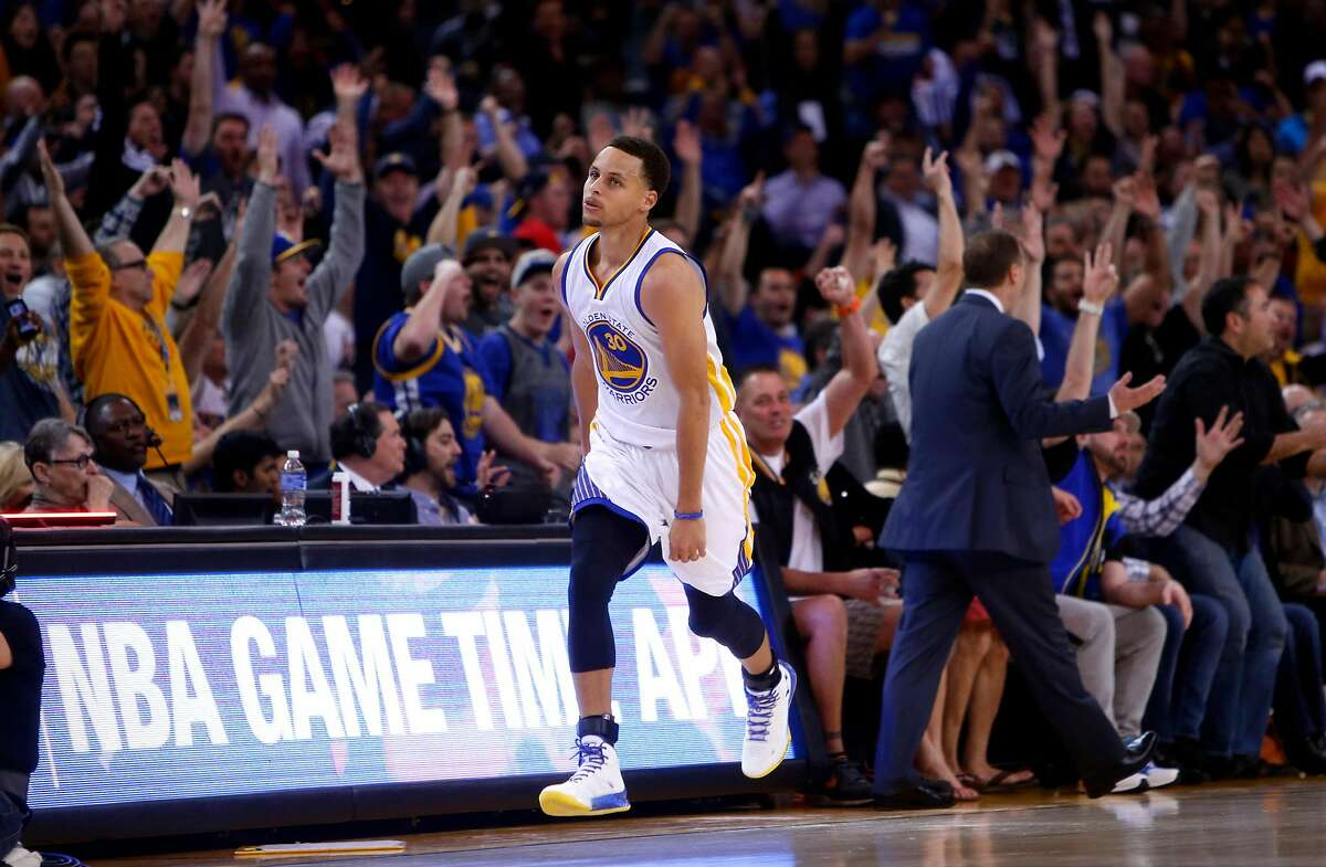 Golden State Warriors' Stephen Curry reacts after hitting 3-pointer and getting fouled in 2nd quarter against Atlanta Hawks during NBA game at Oracle Arena in Oakland, Calif., on Wednesday, March 18, 2015.