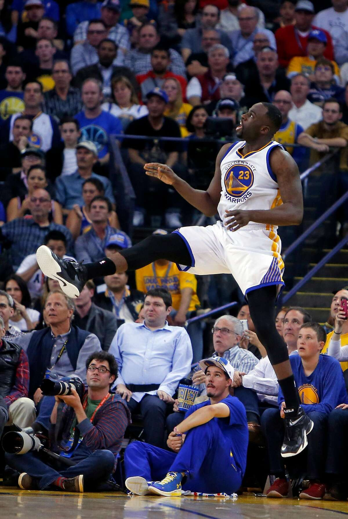 Golden State Warriors' Draymond Green makes an off balance 3-pointer to beat the shot clock in 2nd quarter against Atlanta Hawks during NBA game at Oracle Arena in Oakland, Calif., on Wednesday, March 18, 2015.