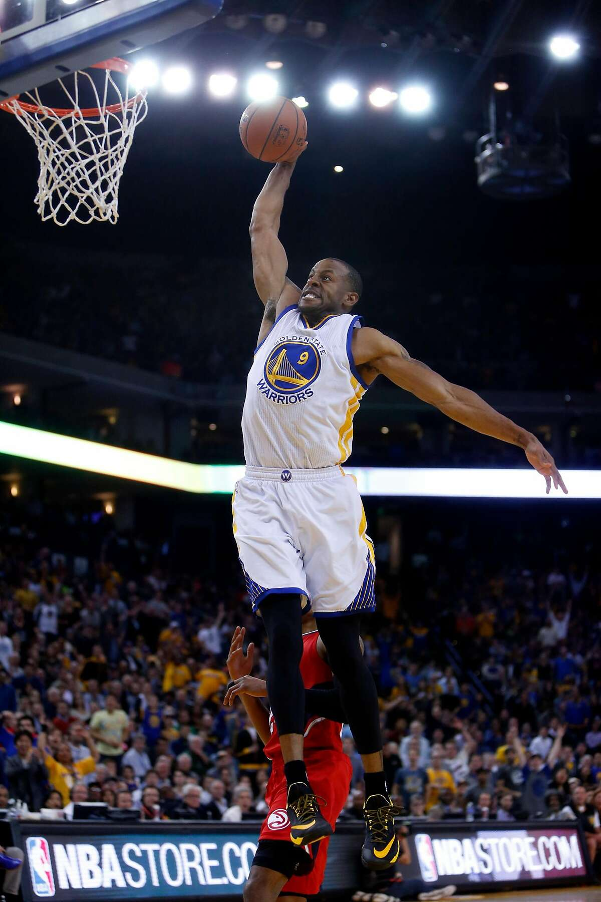 Golden State Warriors' Andre Iguodala dunks against Atlanta Hawks in 4th quarter during NBA game at Oracle Arena in Oakland, Calif., on Wednesday, March 18, 2015.