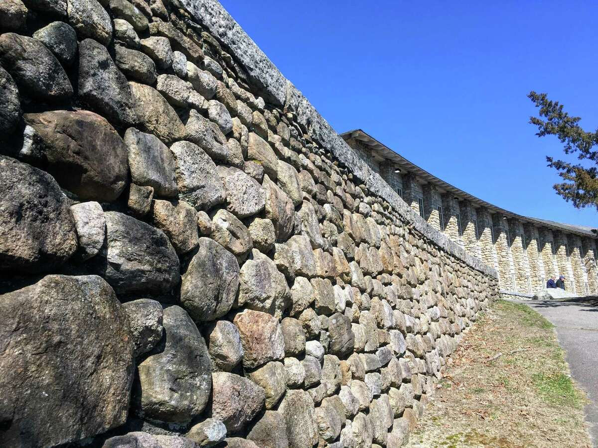 A rock wall and pavilion at Rocky Neck State Park in East Lyme.