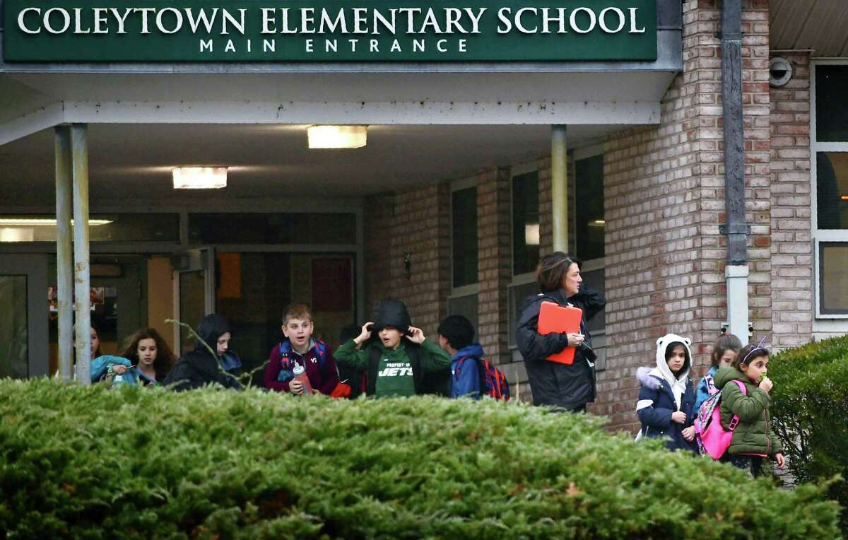 Students leave Coleytown Elementary School Thursday, February 13, 2020, in Westport, Conn.