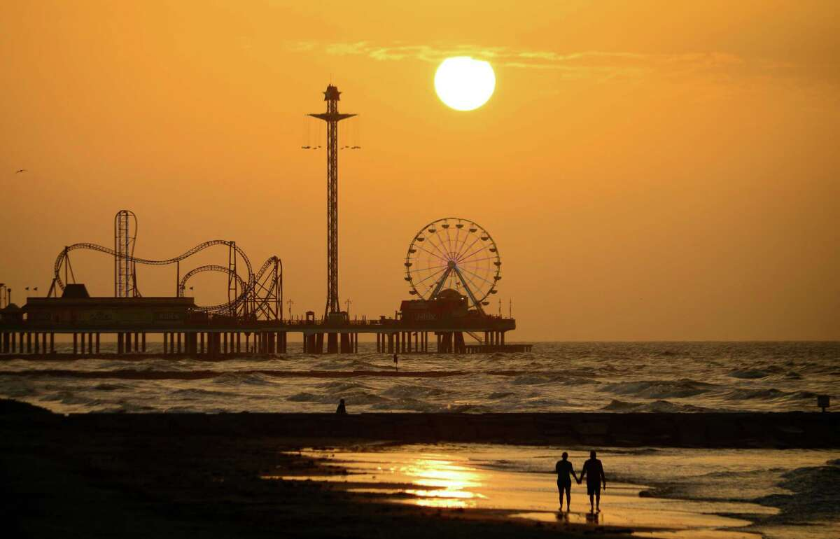A dawn walk along the beach in Galveston may bring a sunrise view of the Pleasure Pier. The city of Galveston will be ordering bars, restaurants and amusement parks such as the Pleasure Pier to close indefinitely due to the coronavirus outbreak, city officials said on March 17, 2020.