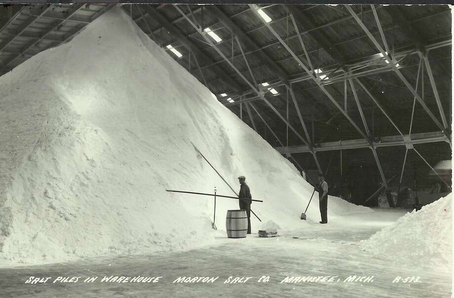 A small mountain of salt is shown in one of the warehouses of Morton Salt in this photo from the 1940s.