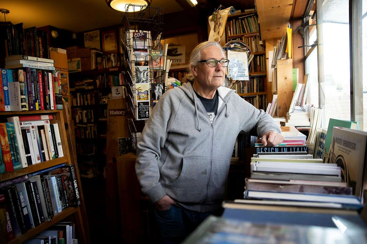A portrait of Eric Whittington at Bird & Beckett Books & Records, Tuesday, March 17, 2020, in San Francisco, Calif. Whittington is the owner of the store, located at 653 Chenery St.